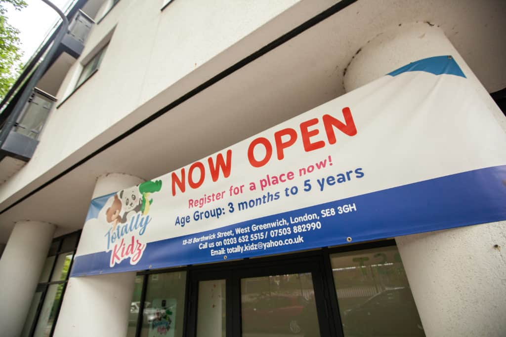 totally kidz now open sign