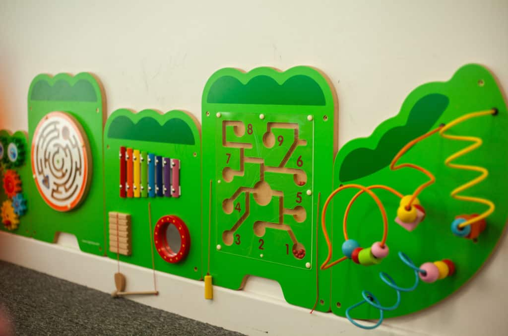 Green play things on the wall