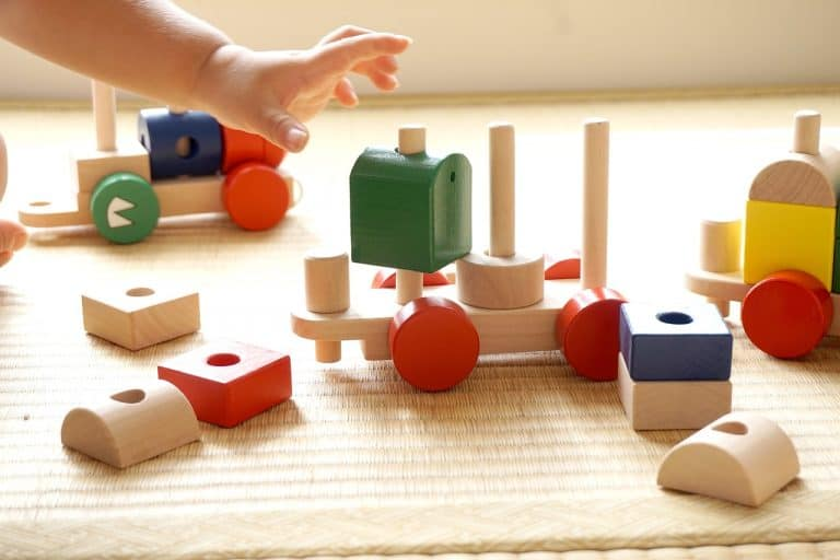 child playing with an array of blocks